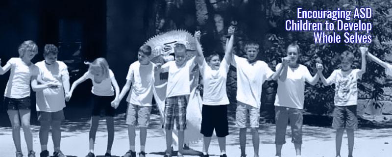 autism kids hands held