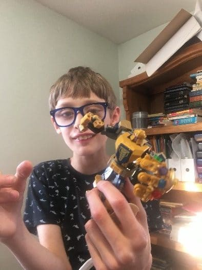 boy playing robot toy