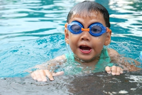 boy swimming with goggles