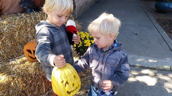 kids with pumpkin
